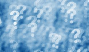 A blue and white collage of blurry question marks.