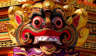 A vibrantly colored mask is featured in a Balinese cremation ceremony in Ubud, Bali.