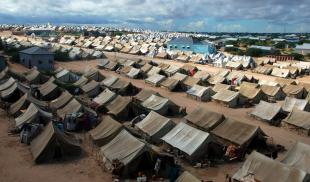 Rows of tents in a Somalian refugee camp as seen from above.