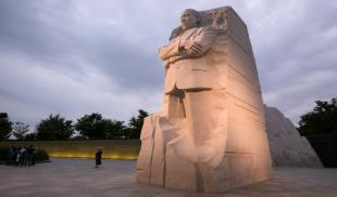The Martin Luther King, Jr. memorial in Washington, D.C. on a cloudy day at dusk.