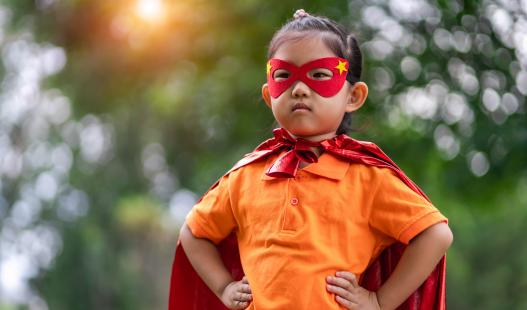 child with a superhero costume