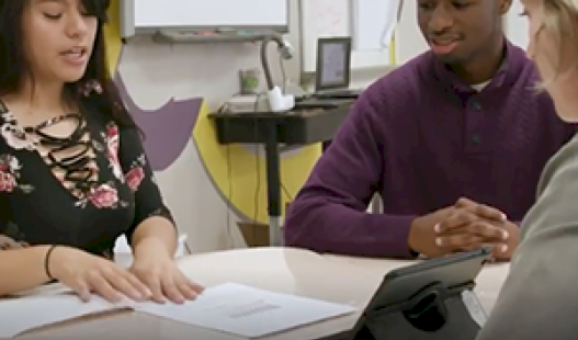 Teacher Telannia Norfar leads her students in The Finance Project in this video
