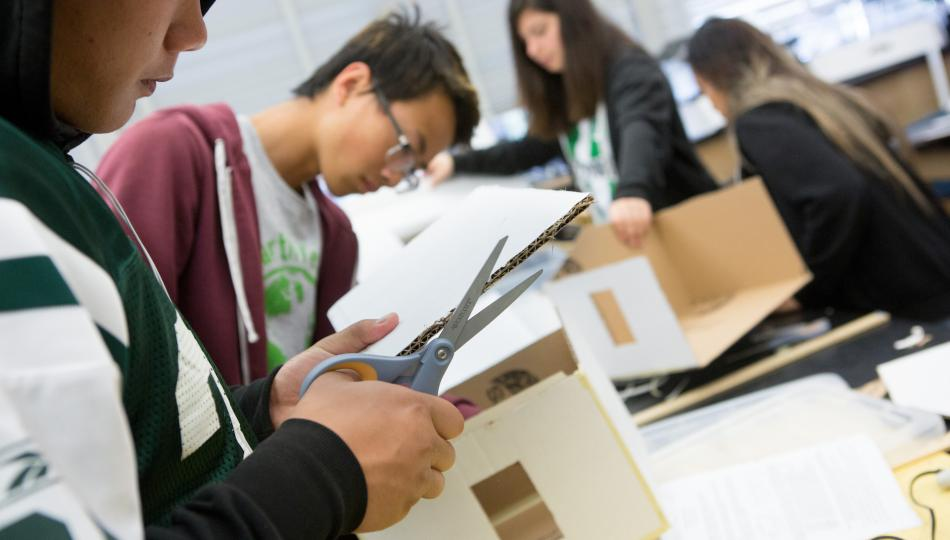 Group of students making structures out of cardboard