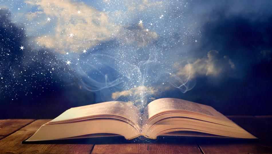An old book lay open on a wooden table, set against a background of glittering stars