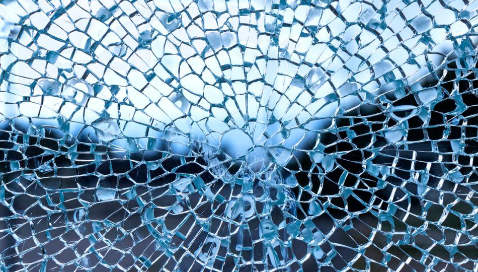 A blue, spider web-like pane of cracked glass.